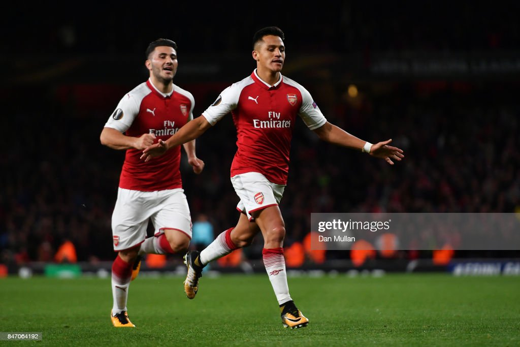 Alexis Sanchez of Arsenal celebrates scoring the 2nd arsenal goal with Sead Kolasinac of Arsenal during the UEFA Europa League group H match between Arsenal FC and 1. FC Koeln at Emirates Stadium on September 14, 2017 in London, United Kingdom.