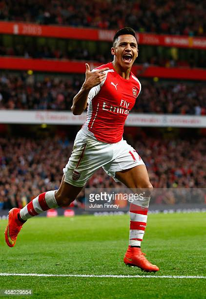 Alexis Sanchez of Arsenal celebrates scoring the first goal during the Barclays Premier League match between Arsenal and Burnley at Emirates Stadium...