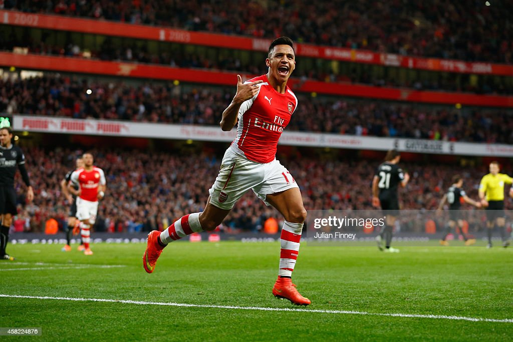 <a gi-track='captionPersonalityLinkClicked' href=/galleries/search?phrase=Alexis+Sanchez&family=editorial&specificpeople=5515162 ng-click='$event.stopPropagation()'>Alexis Sanchez</a> of Arsenal celebrates scoring the first goal for Arsenal during the Barclays Premier League match between Arsenal and Burnley at Emirates Stadium on November 1, 2014 in London, England.