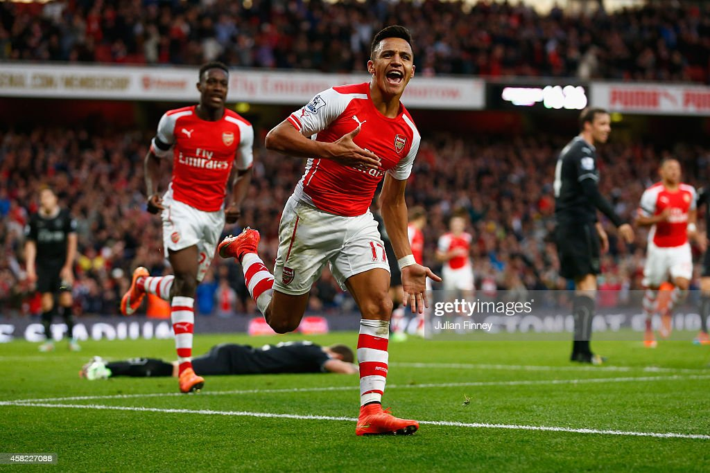 Alexis Sanchez of Arsenal celebrates scoring the first goal for Arsenal during the Barclays Premier League match between Arsenal and Burnley at Emirates Stadium on November 1, 2014 in London, England.