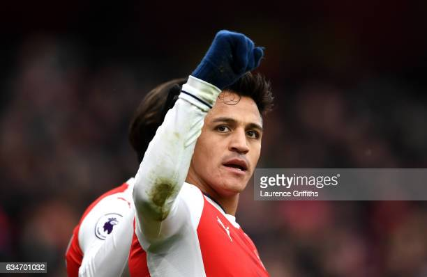 Alexis Sanchez of Arsenal celebrates scoring the opening goal during the Premier League match between Arsenal and Hull City at Emirates Stadium on...