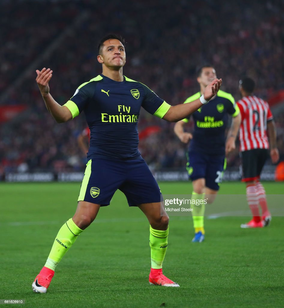 Alexis Sanchez of Arsenal celebrates scoring the opening goal during the Premier League match between Southampton and Arsenal at St Mary's Stadium on May 10, 2017 in Southampton, England.