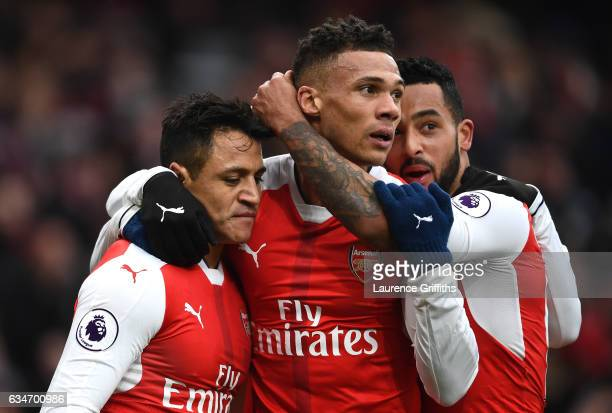 Alexis Sanchez of Arsenal celebrates scoring the opening goal with his team mates Kieran Gibbs and Theo Walcott during the Premier League match...