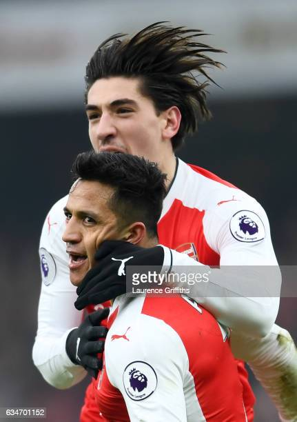 Alexis Sanchez of Arsenal celebrates scoring the opening goal with his team mate Hector Bellerin during the Premier League match between Arsenal and...