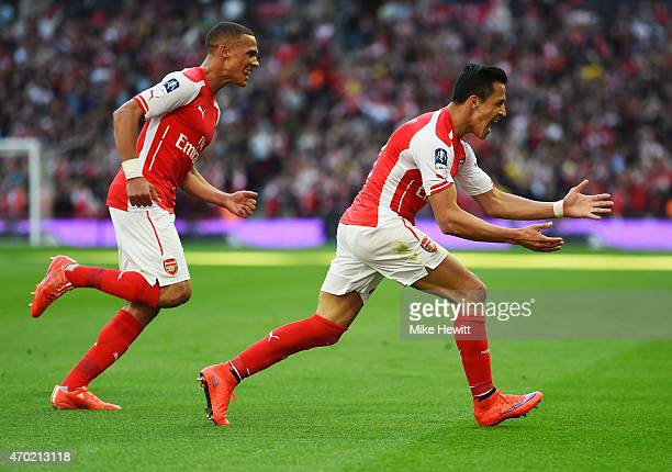 Alexis Sanchez of Arsenal celebrates scoring the the opening goal with Kieran Gibbs of Arsenal during the FA Cup Semi Final between Arsenal and...