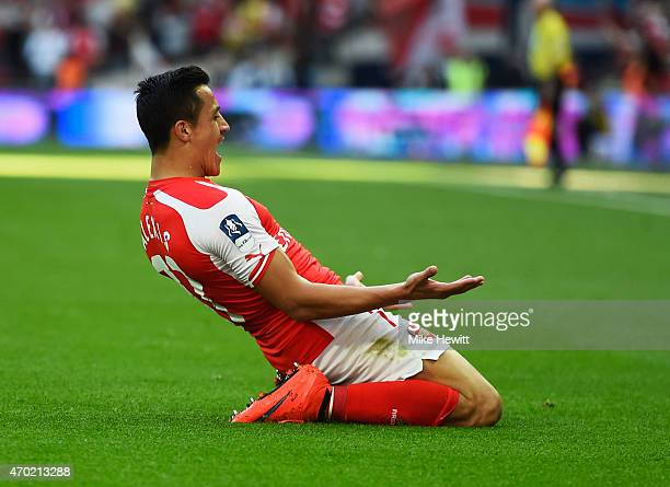 Alexis Sanchez of Arsenal celebrates scoring the the opening goal during the FA Cup Semi Final between Arsenal and Reading at Wembley Stadium on...