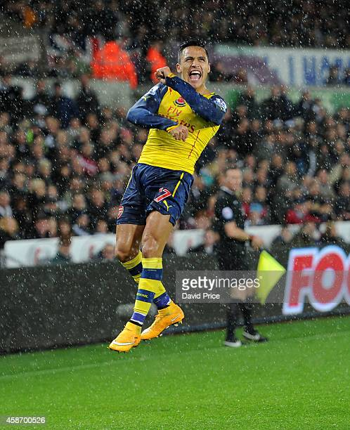 Alexis Sanchez of Arsenal celebrates scoring their goal during the Barclays Premier League match between Swansea and Arsenal at Liberty Stadium on...