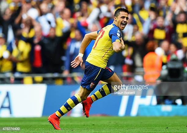Alexis Sanchez of Arsenal celebrates scoring their second goal during the FA Cup Final between Aston Villa and Arsenal at Wembley Stadium on May 30...