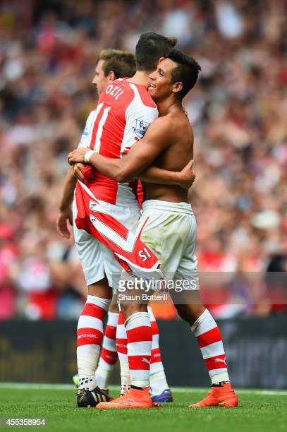 Alexis Sanchez of Arsenal celebrates scoring their second goal with Mesut Oezil of Arsenal during the Barclays Premier League match between Arsenal...