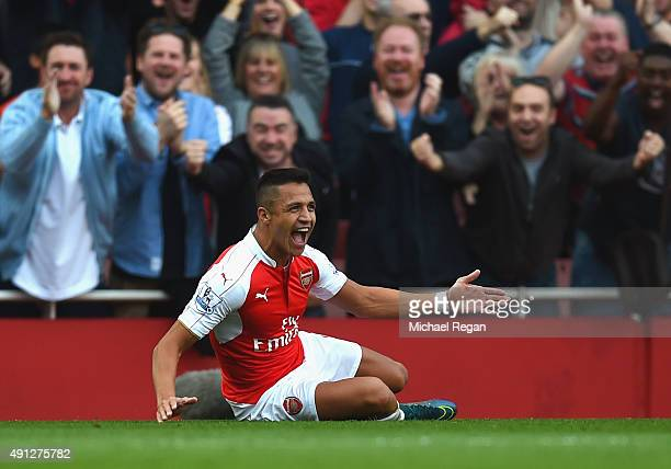 Alexis Sanchez of Arsenal celebrates scoring their third goal during the Barclays Premier League match between Arsenal and Manchester United at...