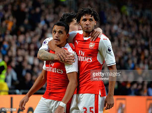 Alexis Sanchez of Arsenal celebrates scoring their third goal with Hector Bellerin and Mohamed Elneny during the Premier League match between Hull...