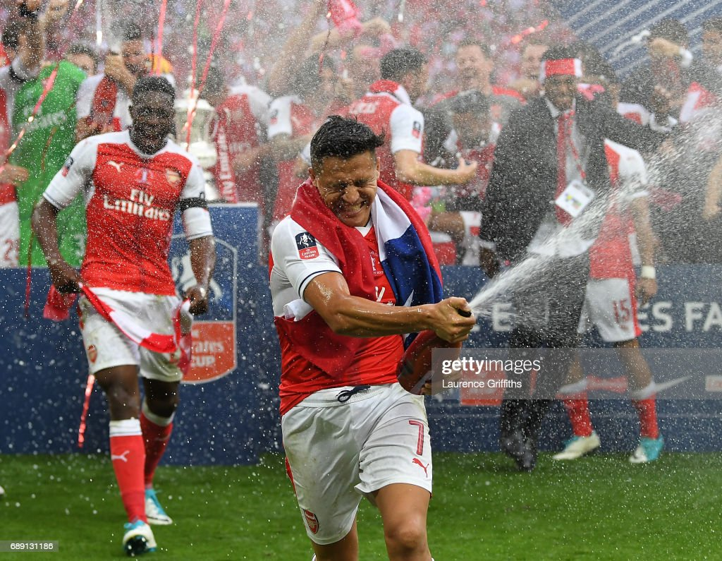 Alexis Sanchez of Arsenal celebrates victory after the Emirates FA Cup Final between Arsenal and Chelsea at Wembley Stadium on May 27, 2017 in London, England.