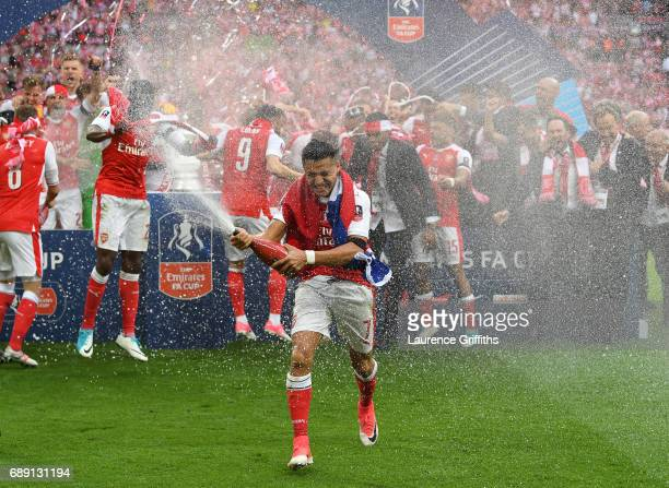 Alexis Sanchez of Arsenal celebrates victory after the Emirates FA Cup Final between Arsenal and Chelsea at Wembley Stadium on May 27 2017 in London...