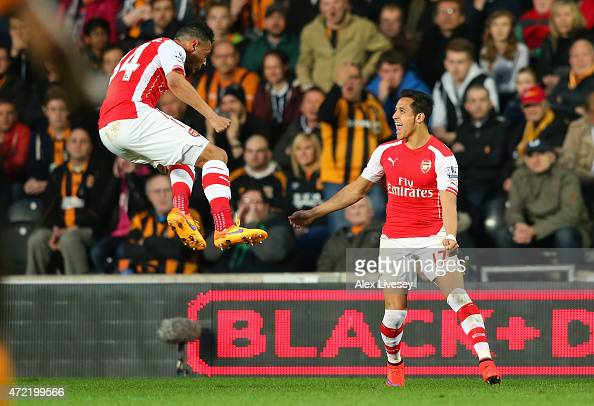Alexis Sanchez of Arsenal celebrates with Francis Coquelin after scoring their first goal during the Barclays Premier League match between Hull City...