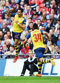 Alexis Sanchez of Arsenal celebrates with Francis Coquelin as eh scores their second goal during the FA Cup Final between Aston Villa and Arsenal at...