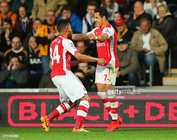 Alexis Sanchez of Arsenal celebrates with Francis Coquelin as he scores their first goal during the Barclays Premier League match between Hull City...