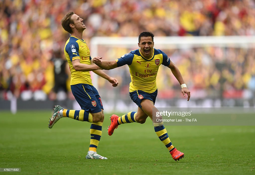 Alexis Sanchez of Arsenal celebrates with his teammate Nacho Monreal after scoring their second goal during the FA Cup Final between Aston Villa and...