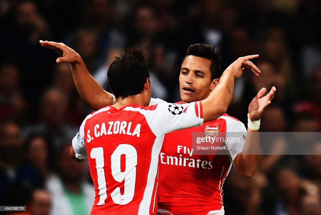 <a gi-track='captionPersonalityLinkClicked' href=/galleries/search?phrase=Alexis+Sanchez&family=editorial&specificpeople=5515162 ng-click='$event.stopPropagation()'>Alexis Sanchez</a> (R) of Arsenal celebrates with team mate <a gi-track='captionPersonalityLinkClicked' href=/galleries/search?phrase=Santi+Cazorla&family=editorial&specificpeople=709830 ng-click='$event.stopPropagation()'>Santi Cazorla</a> of Arsenal after scoring during the UEFA Champions League Qualifier 2nd leg match between Arsenal and Besiktas at the Emirates Stadium on August 27, 2014 in London, United Kingdom.