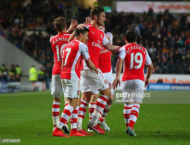 Alexis Sanchez of Arsenal celebrates with team mates as he scores their third goal during the Barclays Premier League match between Hull City and...