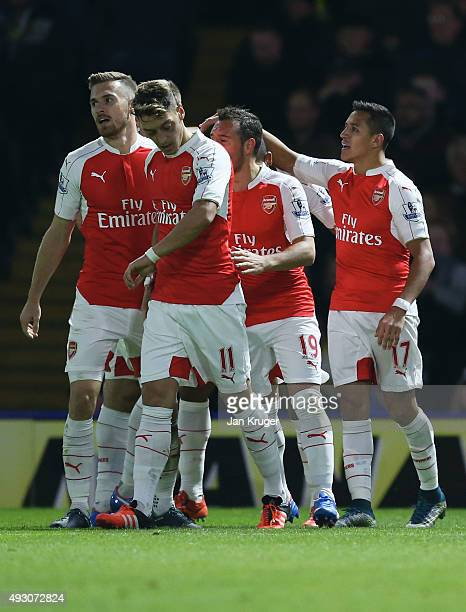 Alexis Sanchez of Arsenal celebrates with team mates as he scores their first goal during the Barclays Premier League match between Watford and...