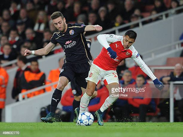 Alexis Sanchez of Arsenal challenged by Ivo Pinto of Zagreb during the match between Arsenal and Dinamo Zagreb in the UEFA Champions League on...