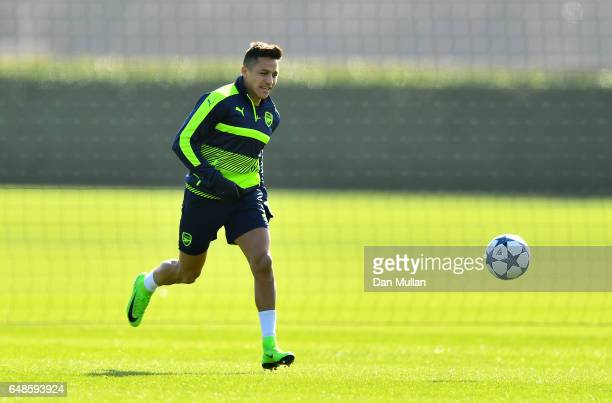 Alexis Sanchez of Arsenal chases down the ball during a training session at London Colney on March 6 2017 in St Albans England