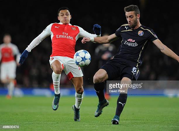 Alexis Sanchez of Arsenal closes down Ivo Pinto of Zagreb during the match between Arsenal and Dinamo Zagreb in the UEFA Champions League on November...