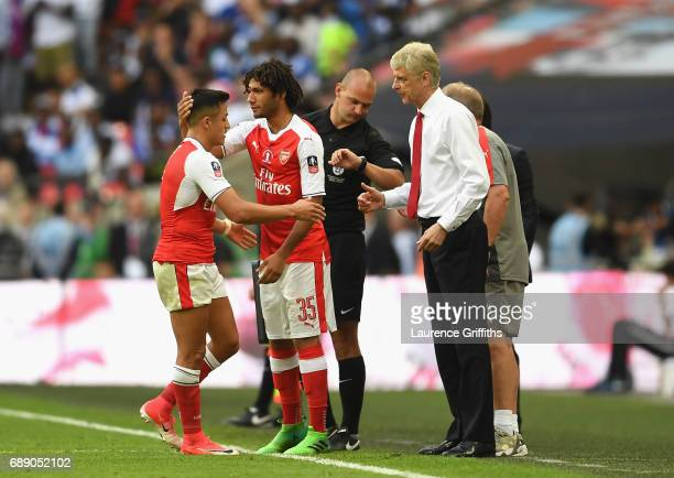 Alexis Sanchez of Arsenal comes off for Mohamed Elneny of Arsenal during The Emirates FA Cup Final between Arsenal and Chelsea at Wembley Stadium on...