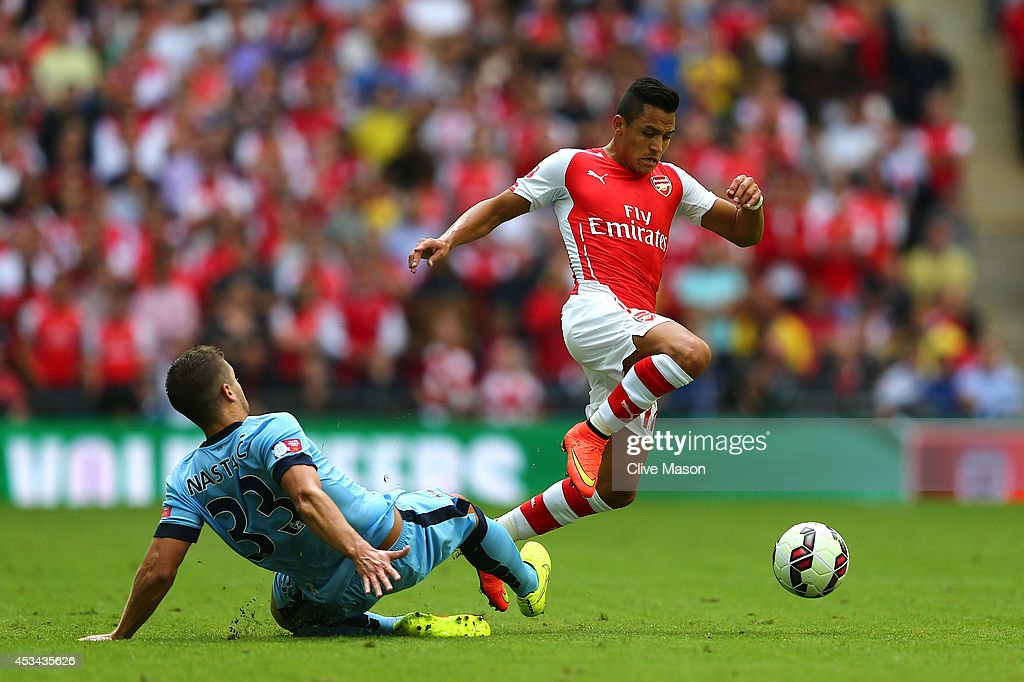 <a gi-track='captionPersonalityLinkClicked' href=/galleries/search?phrase=Alexis+Sanchez&family=editorial&specificpeople=5515162 ng-click='$event.stopPropagation()'>Alexis Sanchez</a> of Arsenal competes for the ball with Matija Nastasic of Manchester City during the FA Community Shield match Manchester City and Arsenal at Wembley Stadium on August 10, 2014 in London, England.