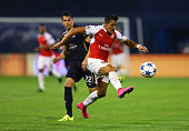Alexis Sanchez of Arsenal controls the ball as he is closed down by Leonardo Sigali of Dinamo Zagreb during the UEFA Champions League Group F match...