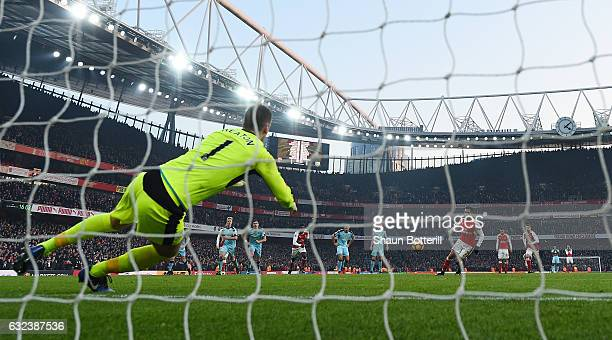 Alexis Sanchez of Arsenal converts the penalty to score his side's second goal during the Premier League match between Arsenal and Burnley at the...