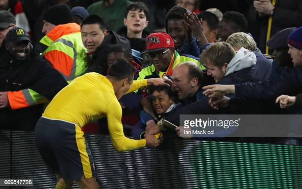 Alexis Sanchez of Arsenal hands his shirt to a young fan after the Premier League match between Middlesbrough and Arsenal at Riverside Stadium on...