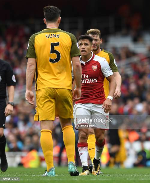 Alexis Sanchez of Arsenal has words with Lewis Dunk of Brighton during the Premier League match between Arsenal and Brighton and Hove Albion at...