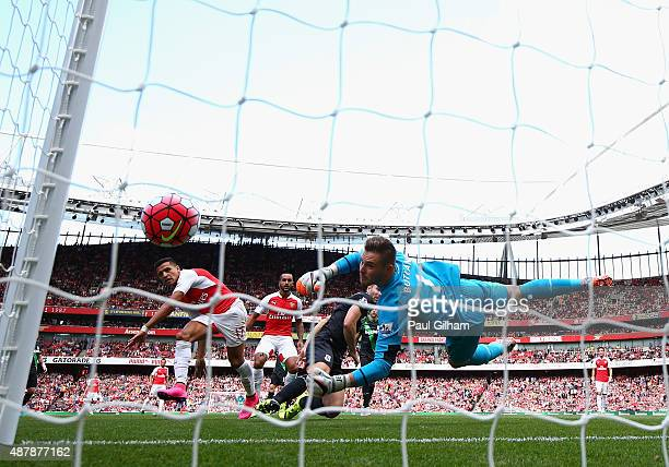 Alexis Sanchez of Arsenal heads a shot at goal only for it to hit the post as Jack Butland of Stoke City looks on during the Barclays Premier League...