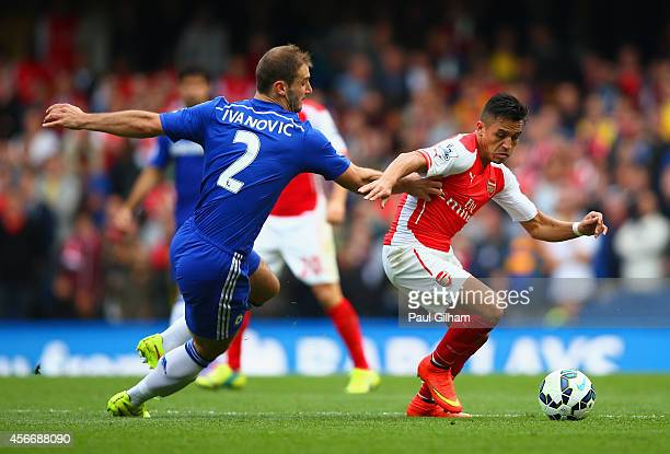 Alexis Sanchez of Arsenal holds off Branislav Ivanovic of Chelsea during the Barclays Premier League match between Chelsea and Arsenal at Stamford...