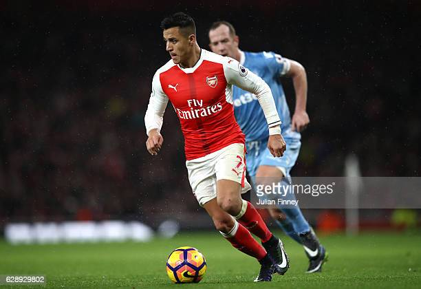 Alexis Sanchez of Arsenal in action during the Premier League match between Arsenal and Stoke City at the Emirates Stadium on December 10 2016 in...