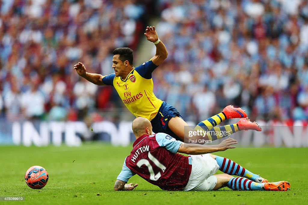 <a gi-track='captionPersonalityLinkClicked' href=/galleries/search?phrase=Alexis+Sanchez&family=editorial&specificpeople=5515162 ng-click='$event.stopPropagation()'>Alexis Sanchez</a> of Arsenal is challenged by <a gi-track='captionPersonalityLinkClicked' href=/galleries/search?phrase=Alan+Hutton&family=editorial&specificpeople=839355 ng-click='$event.stopPropagation()'>Alan Hutton</a> of Aston Villa during the FA Cup Final between Aston Villa and Arsenal at Wembley Stadium on May 30, 2015 in London, England.