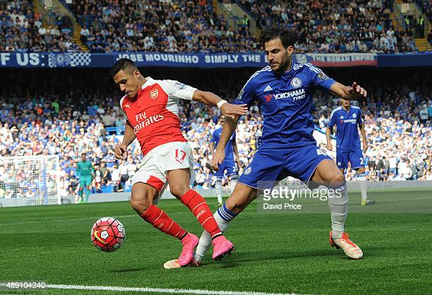 Alexis Sanchez of Arsenal is challenged by Cesc Fabregas of Chelsea during the Barclays Premier League match between Chelsea and Arsenal on September...