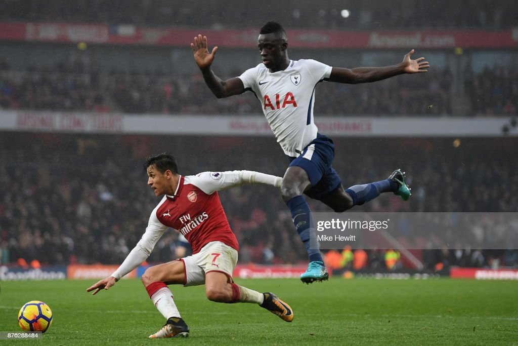 Alexis Sanchez of Arsenal is challenged by Davinson Sanchez of Tottenham during the Premier League match between Arsenal and Tottenham Hotspur at Emirates Stadium on November 18, 2017 in London, England.