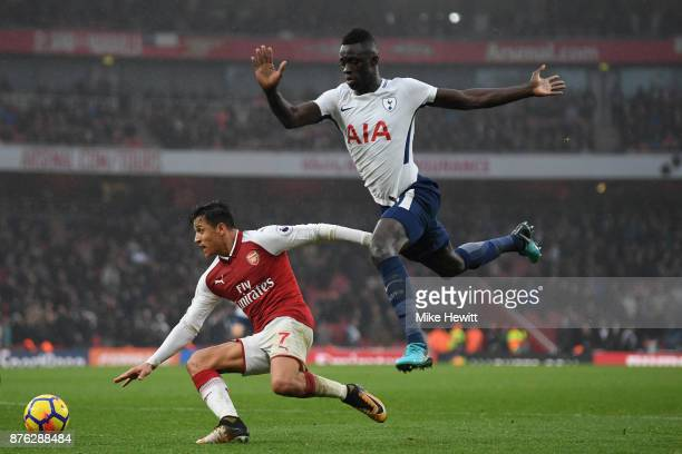 Alexis Sanchez of Arsenal is challenged by Davinson Sanchez of Tottenham during the Premier League match between Arsenal and Tottenham Hotspur at...