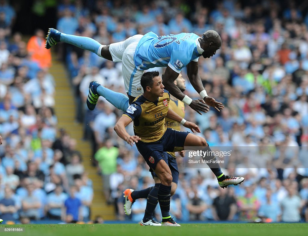 http://media.gettyimages.com/photos/alexis-sanchez-of-arsenal-is-challenged-by-eliaquim-mangala-of-man-picture-id529161654