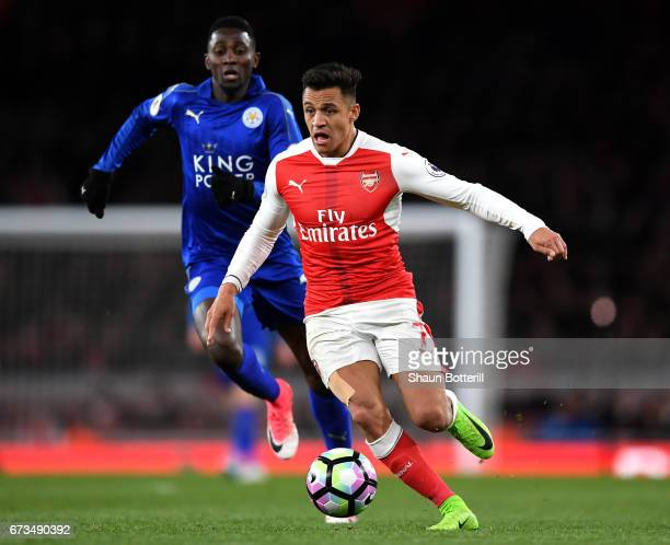 Alexis Sanchez of Arsenal is chased down by Wilfred Ndidi of Leicester City during the Premier League match between Arsenal and Leicester City at the...