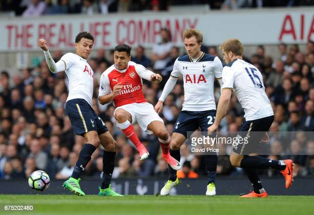 Alexis Sanchez of Arsenal is closed down by Dele Alli Christian Eriksen and Eric Dier of Tottenham during the Premier League match between Tottenham...