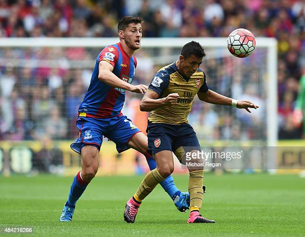 Alexis Sanchez of Arsenal is closed down by Joel Ward of Crystal Palace during the Barclays Premier League match between Crystal Palace and Arsenal...