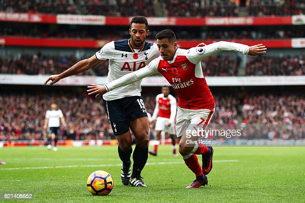 Alexis Sanchez of Arsenal is closed down by Mousa Dembele of Tottenham Hotspur during the Premier League match between Arsenal and Tottenham Hotspur...