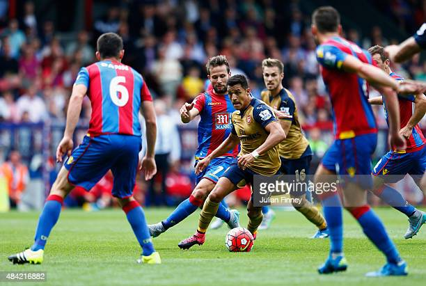 Alexis Sanchez of Arsenal is closed down by Yohan Cabaye of Crystal Palace during the Barclays Premier League match between Crystal Palace and...