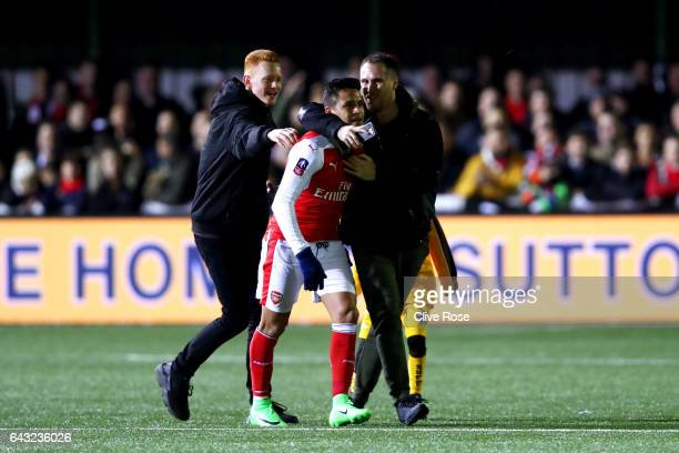 Alexis Sanchez of Arsenal is congratulated by fans on the pitch after the Emirates FA Cup fifth round match between Sutton United and Arsenal on...