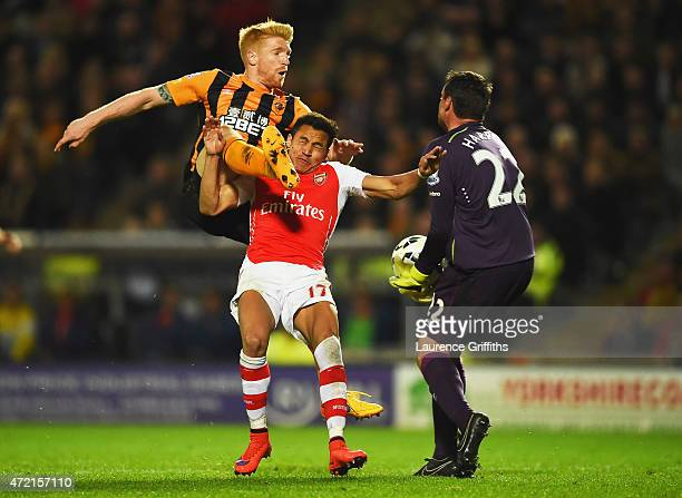 Alexis Sanchez of Arsenal is foiled by Paul McShane and Steve Harper of Hull City during the Barclays Premier League match between Hull City and...