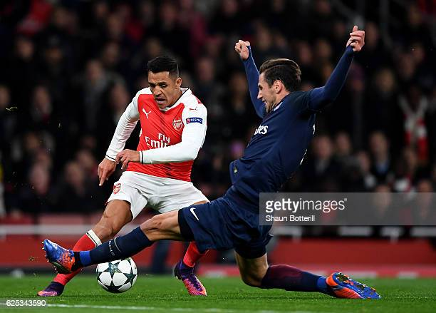 Alexis Sanchez of Arsenal is fouled by Grzegorz Krychowiak of PSG and a penalty is awarded to Arsenal during the UEFA Champions League Group A match...