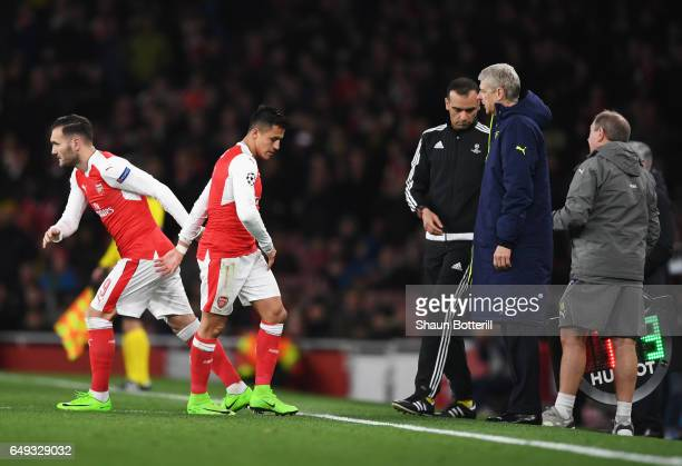 Alexis Sanchez of Arsenal is substituted for Lucas Perez of Arsenal during the UEFA Champions League Round of 16 second leg match between Arsenal FC...